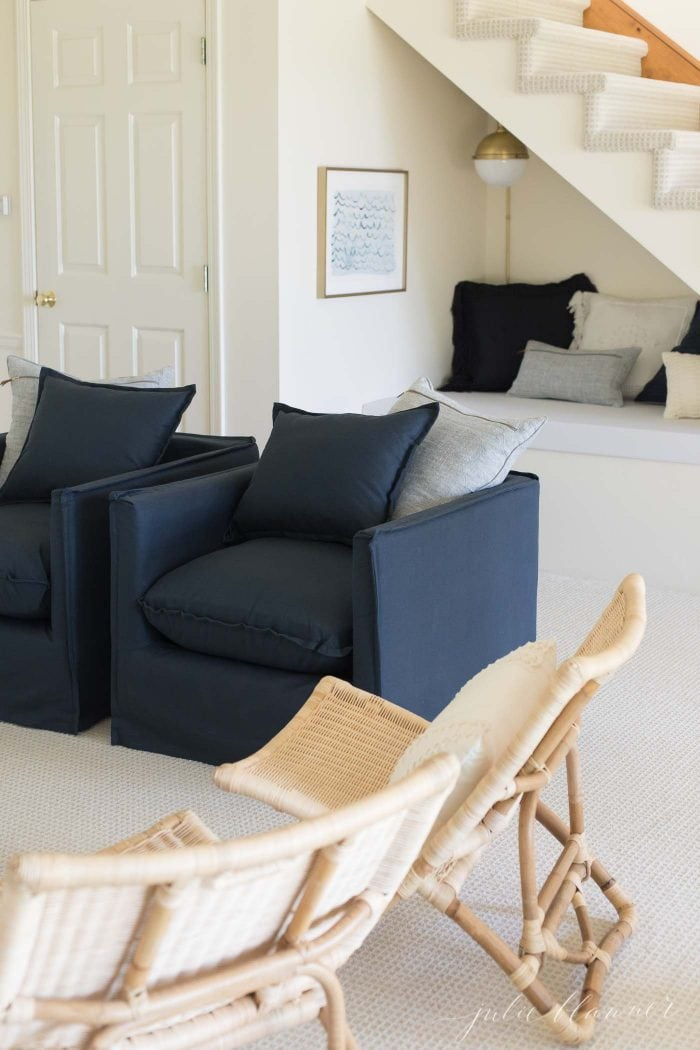 A modern living room with navy accents.
