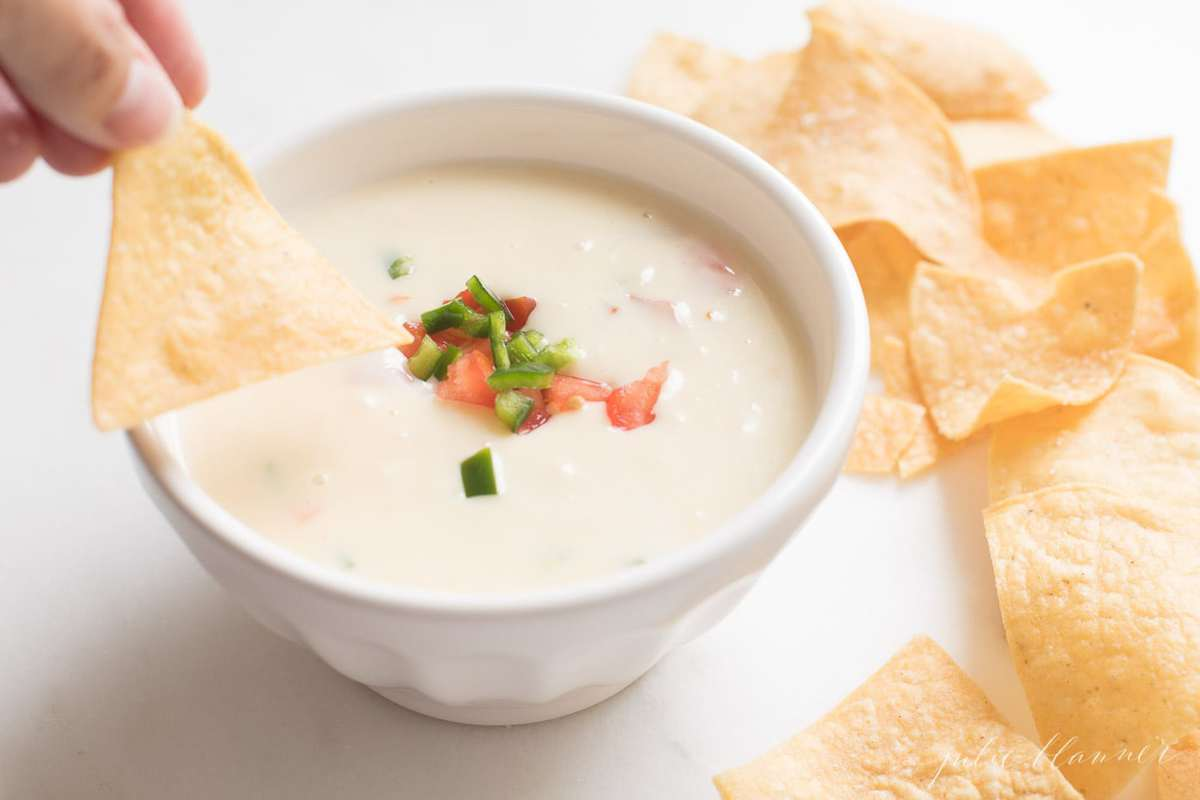 queso blanco in a white bowl with tortilla chips