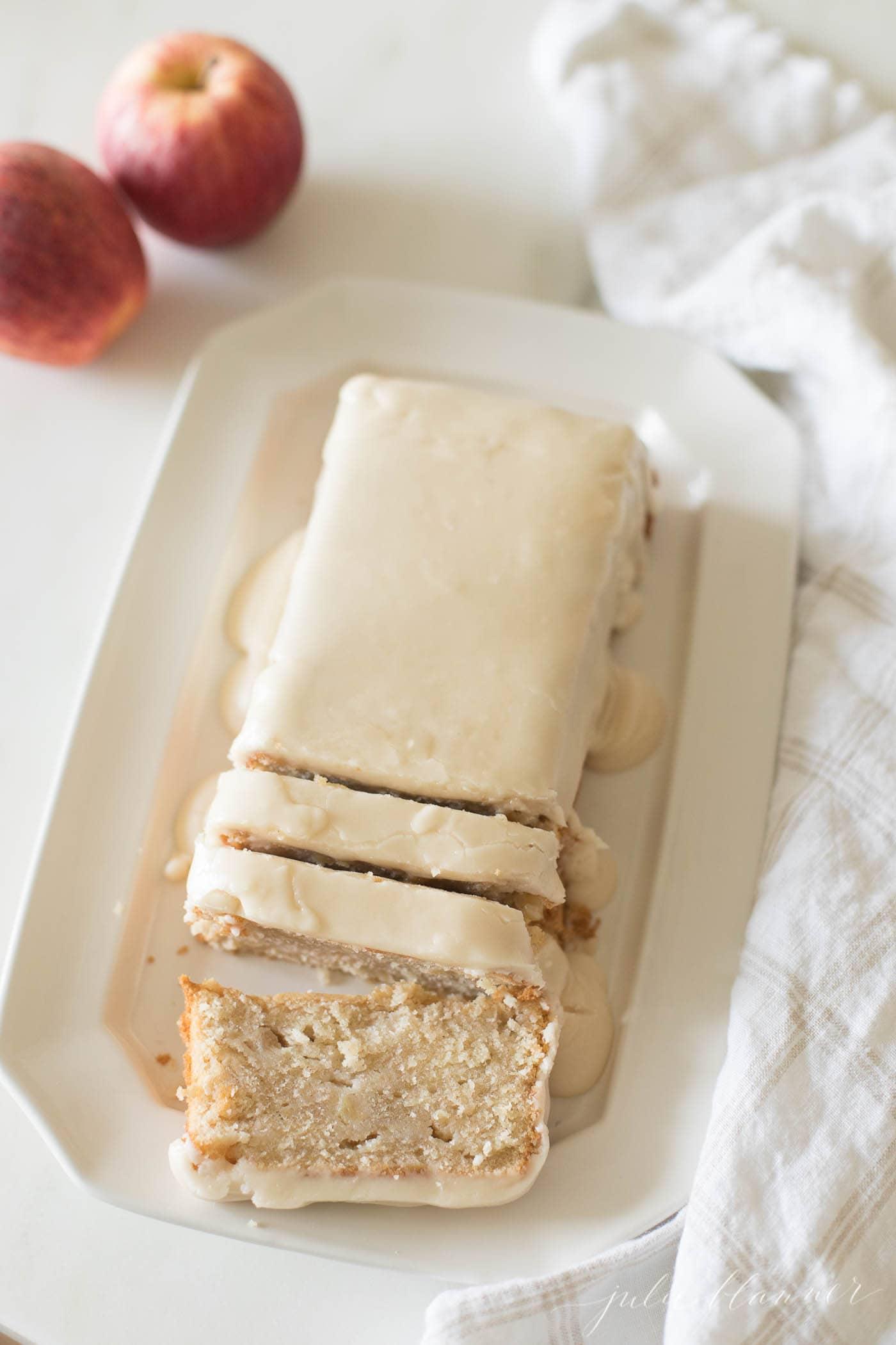 apple pound cake sliced on a white platter