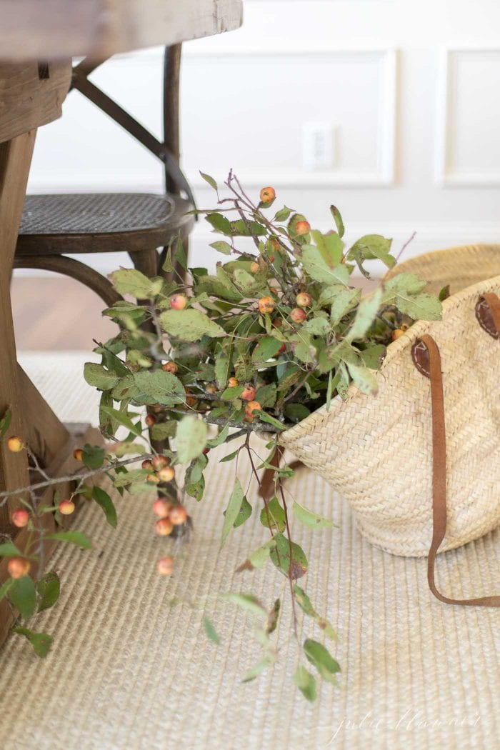 crabapple branches in market bag on sisal rug