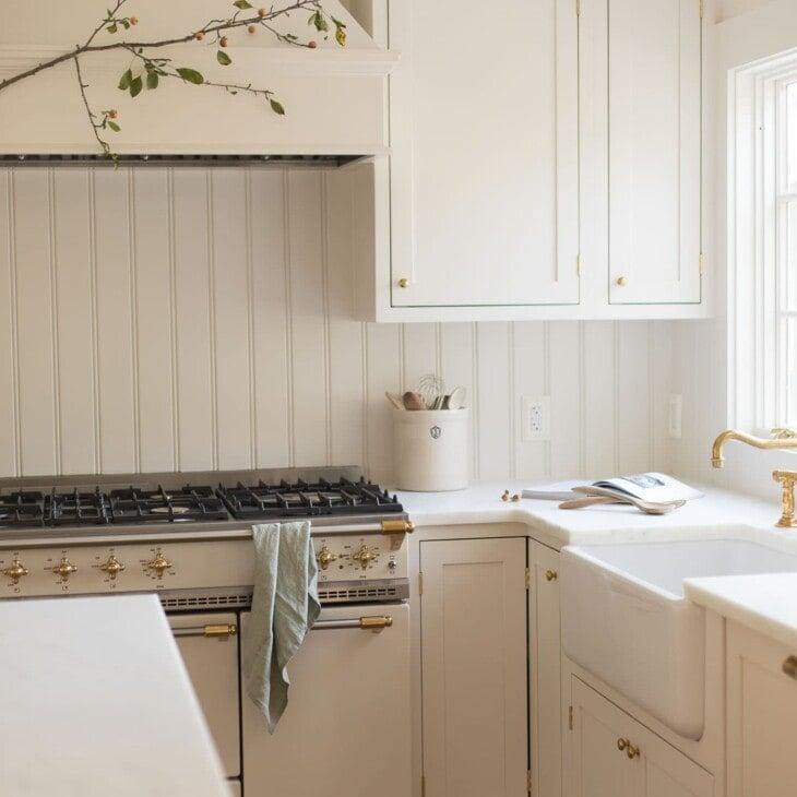 cream kitchen with crabapple branch on range hood