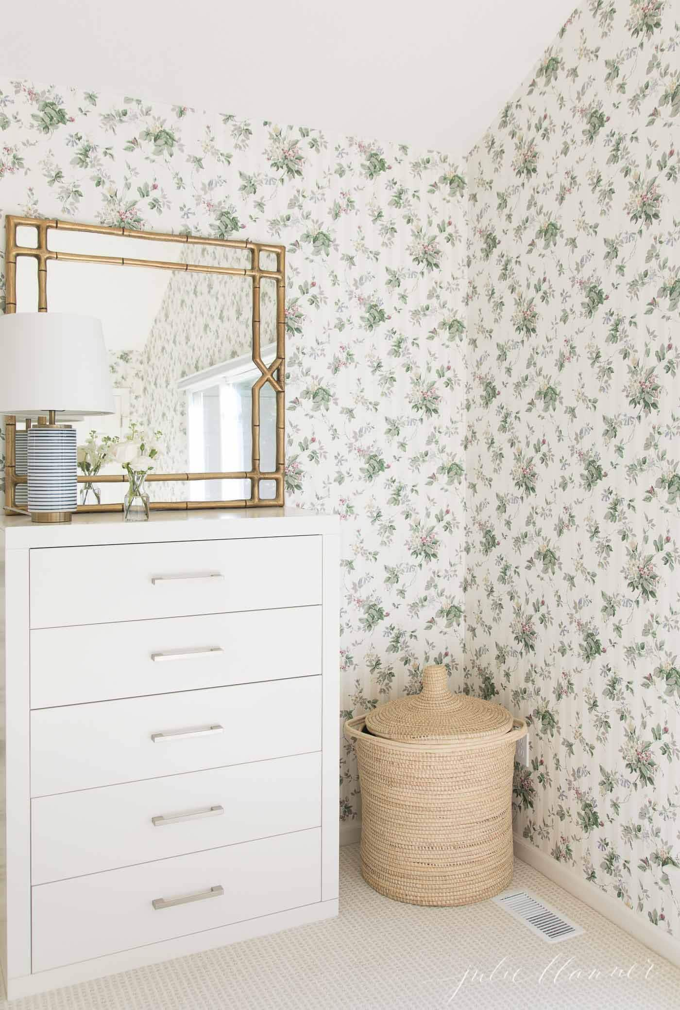 patterned carpet and floral wallpaper in a bedroom