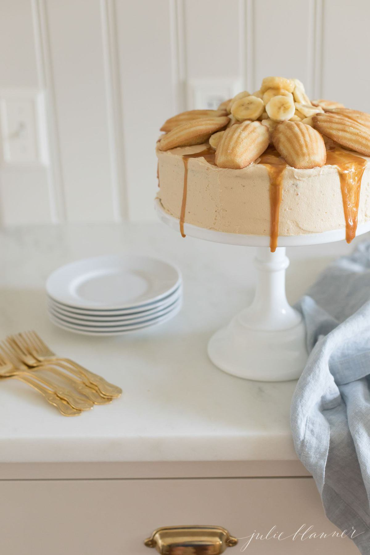 A cake on a stand with Salted Caramel Frosting