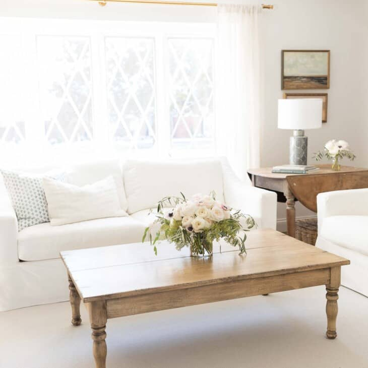 A custom indoor outdoor sisal rug in a white living room.