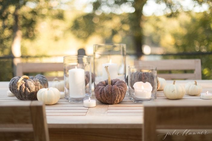 pumpkins and candles on table