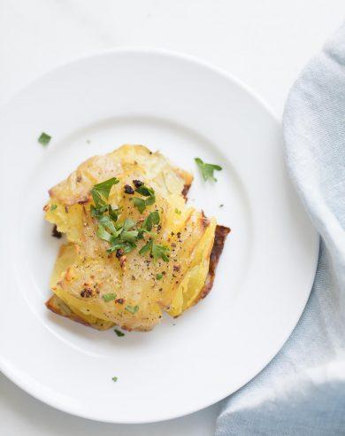 garlic smashed potatoes garnished with herbs