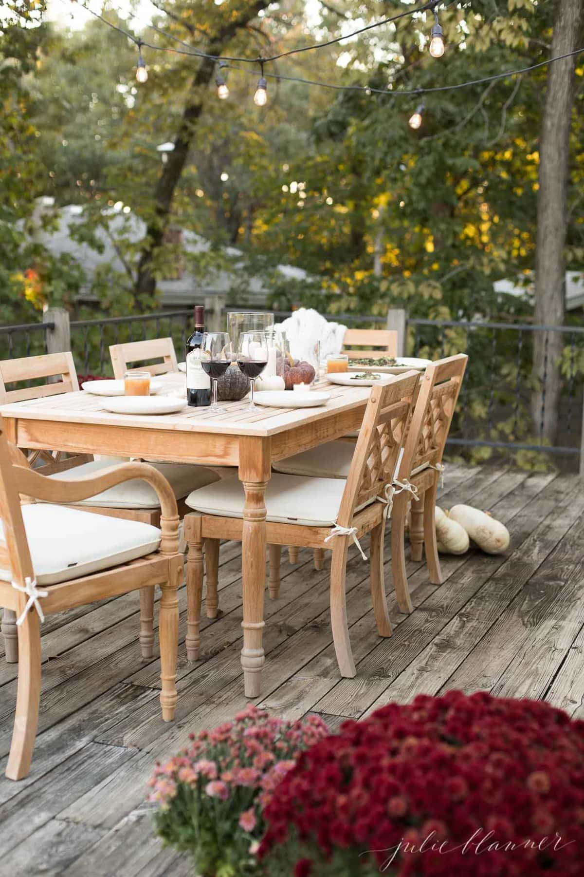 Add lights to a deck or patio to dine al fresco during the fall months