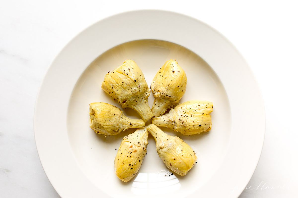 artichoke vegetable in a white serving dish