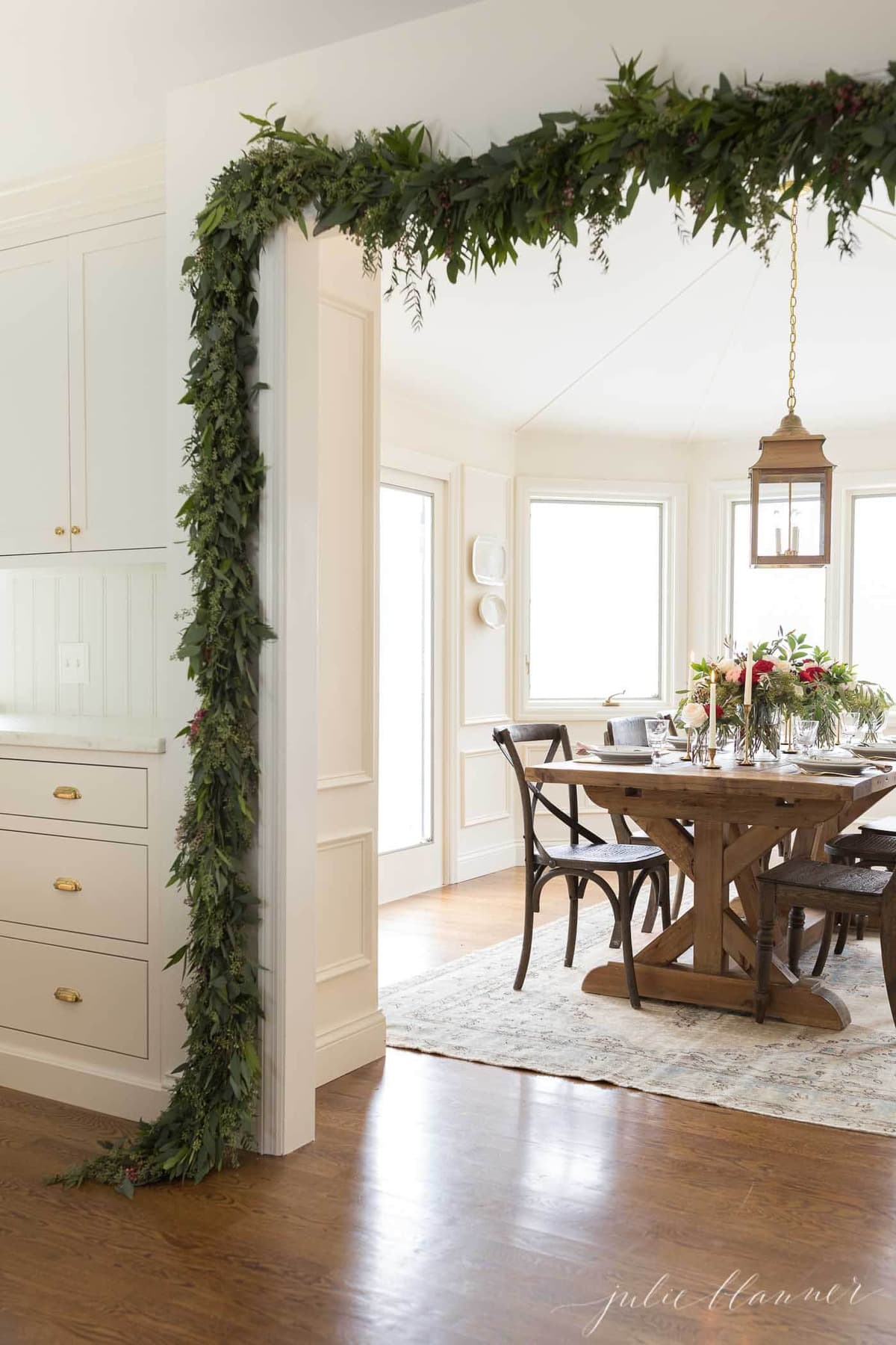 christmas garland around doorframe