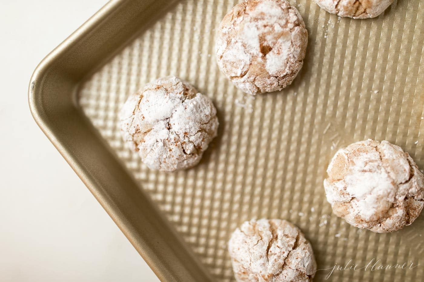 Top shot of gooey butter eggnog cookies on a baking sheet