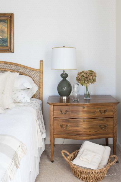 rattan bed with wood side table