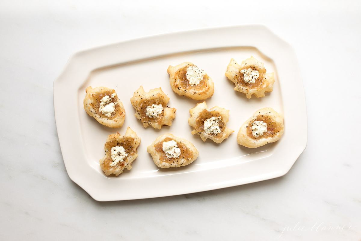 bite sized onion tarts on a platter