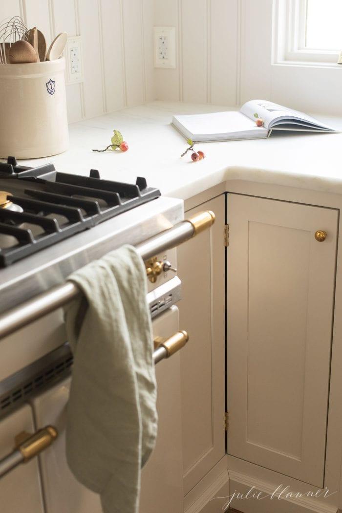 cream kitchen with brass hardware