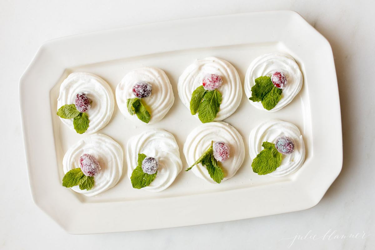meringue cookies on a white serving platter