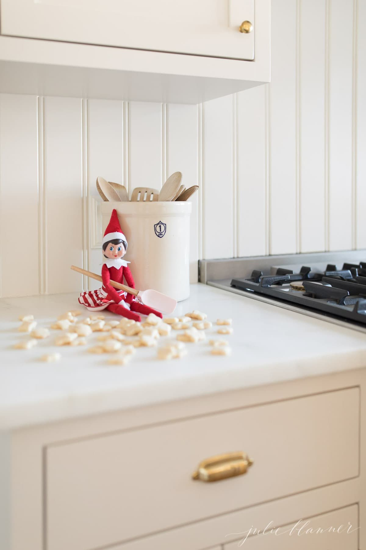 Mini cookies in front of a elf on the shelf
