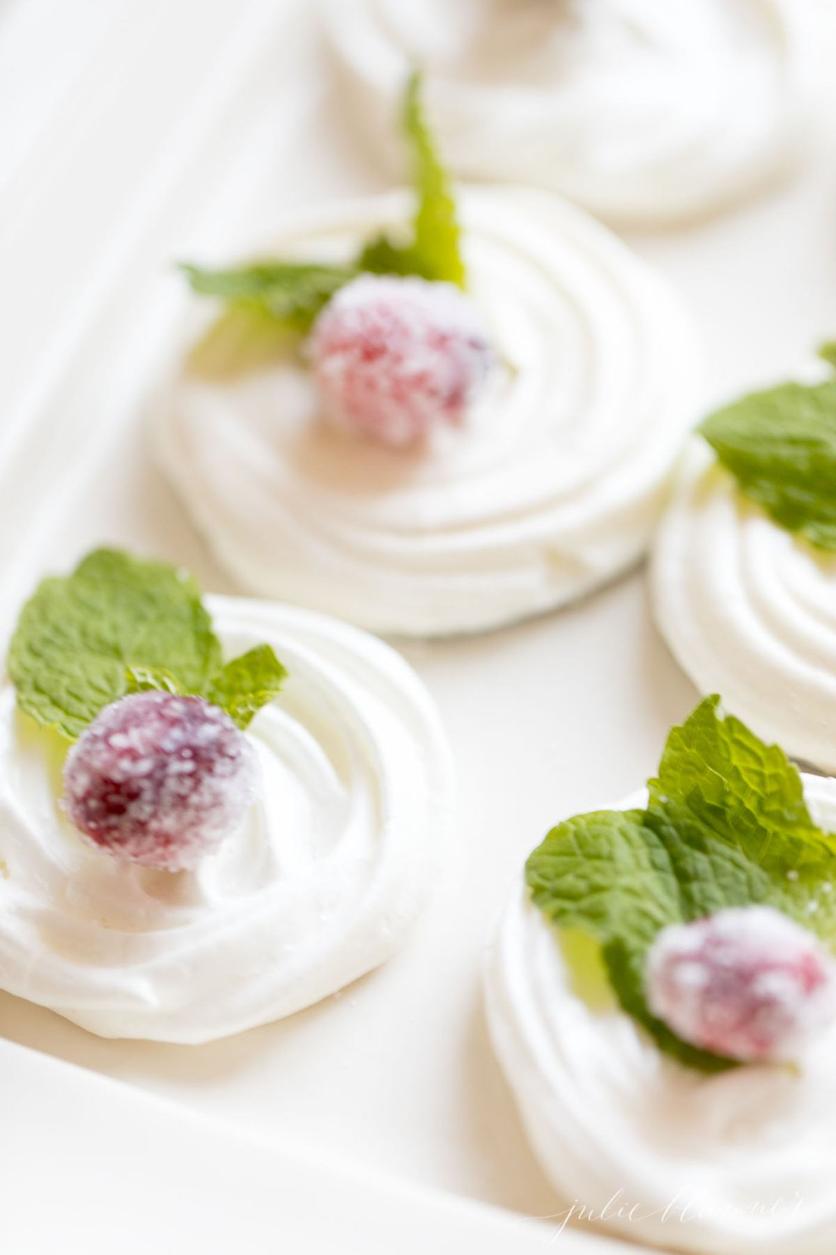 Decorated meringues on a serving tray