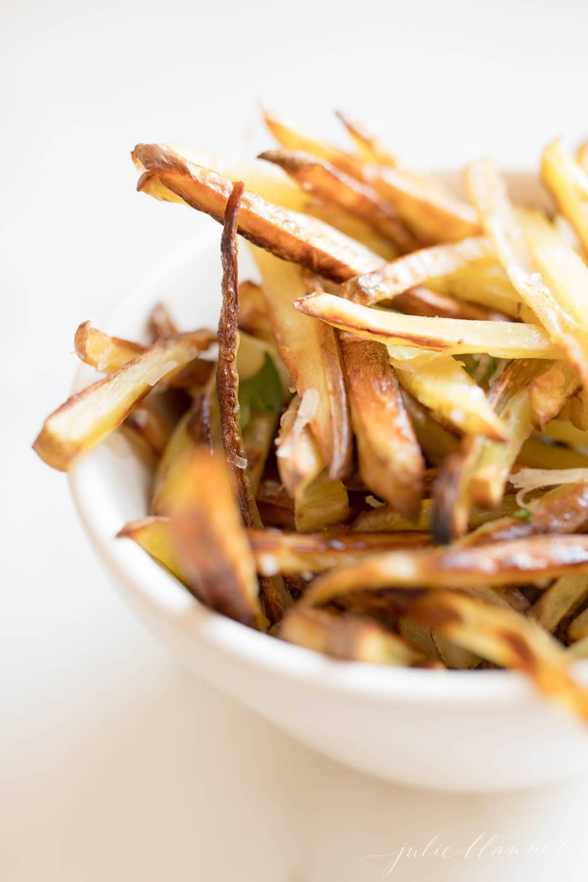 fries in a white bowl