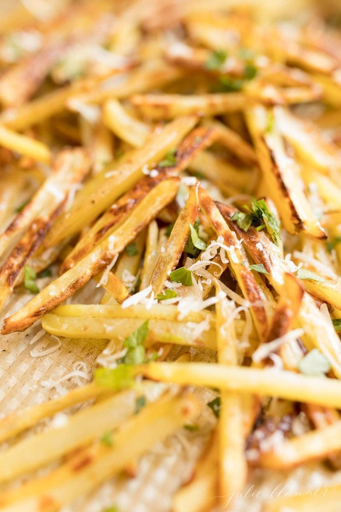 fries with Parmesan and parsley on a sheet pan