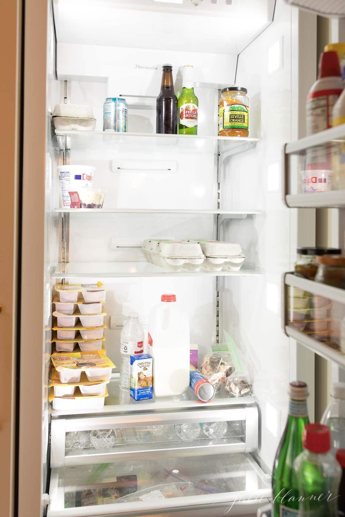 unorganized refrigerator BEFORE using fridge organization containers.