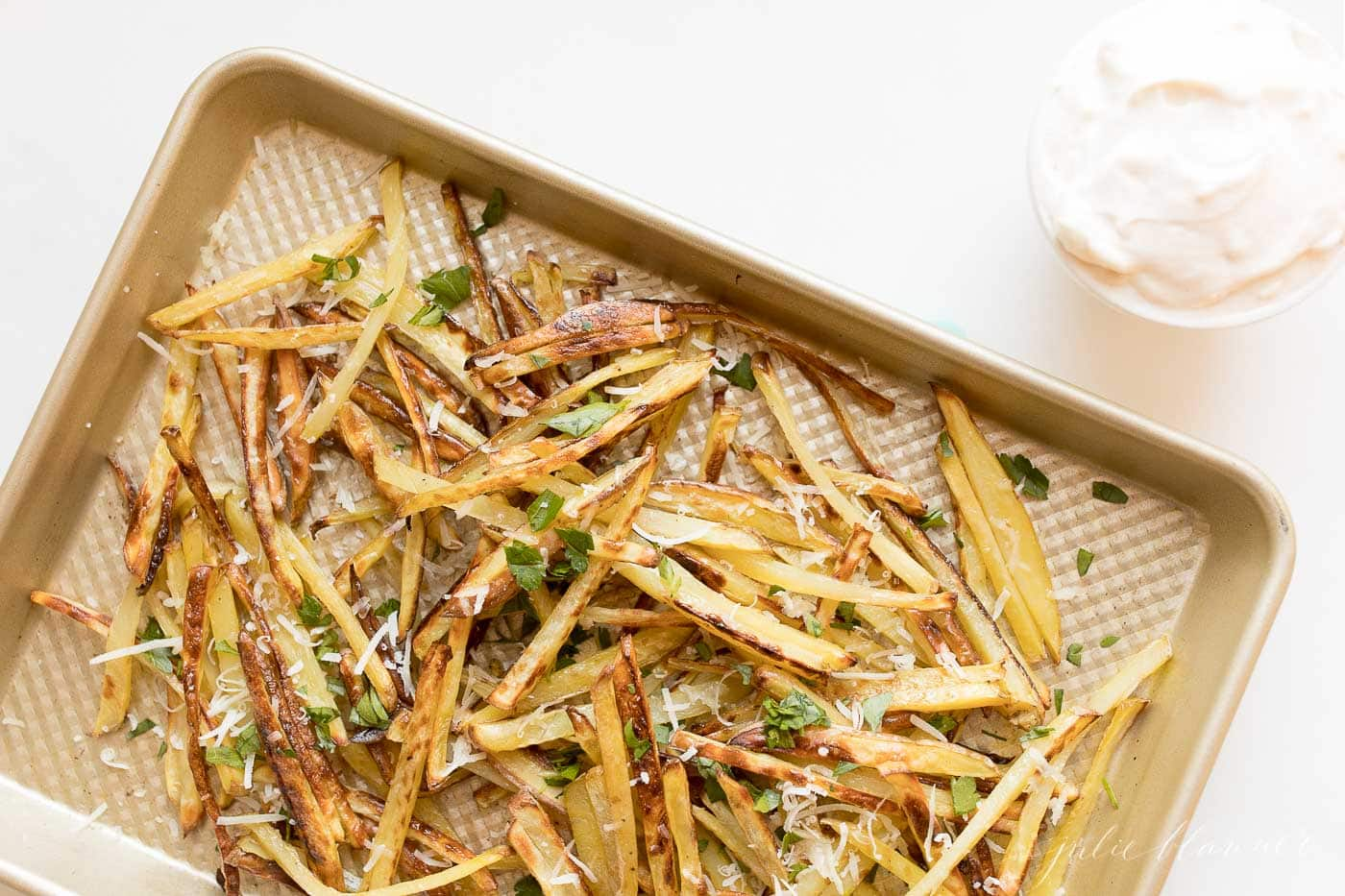 truffle fries with Parmesan and parsley on a sheet pan