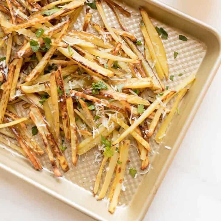 truffle fries on gold baking sheet