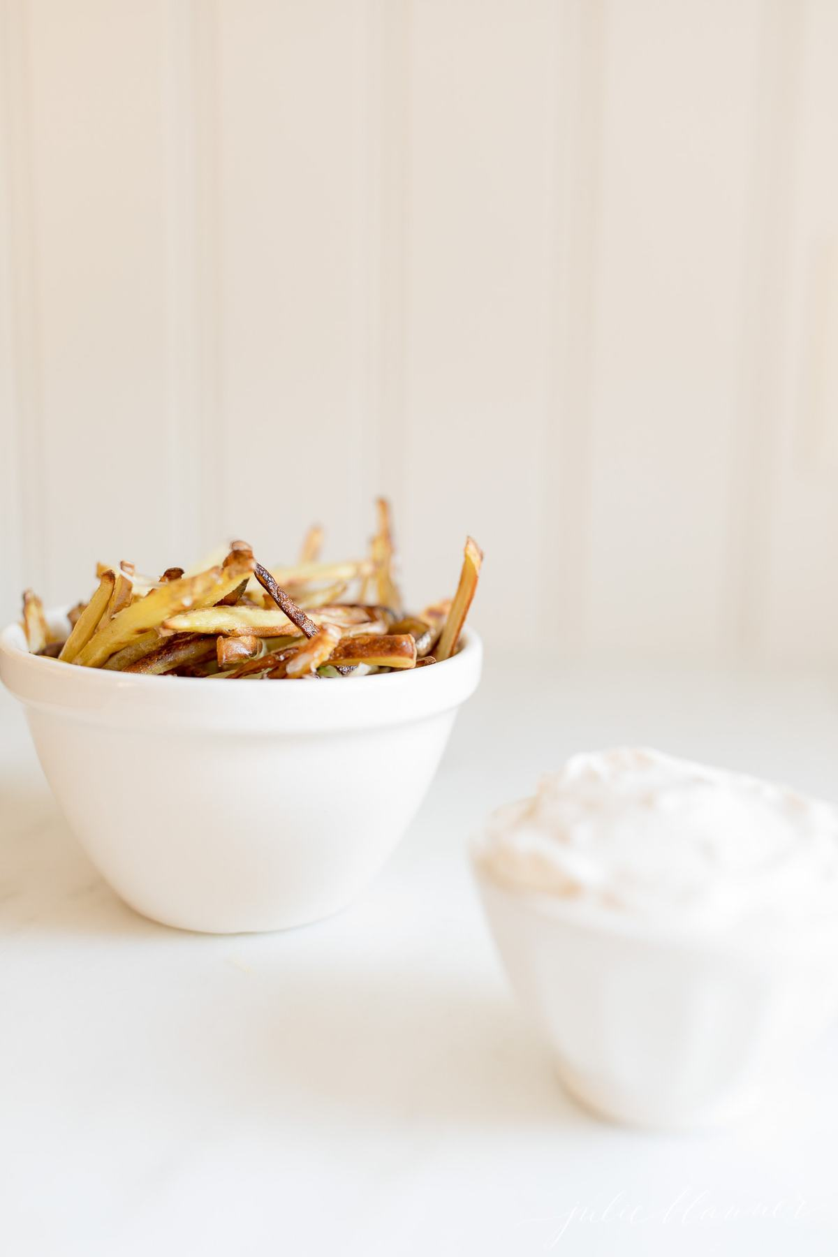 truffle fries in a white bowl