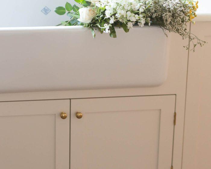 how to organize under kitchen sink