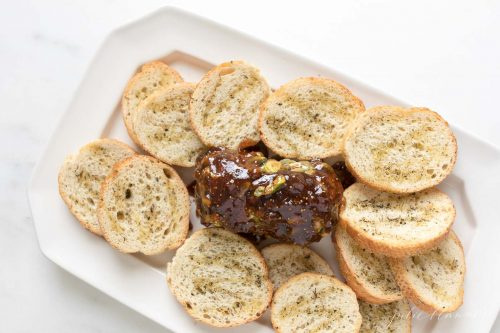 chevre cheese covered in pistachios and fig jam