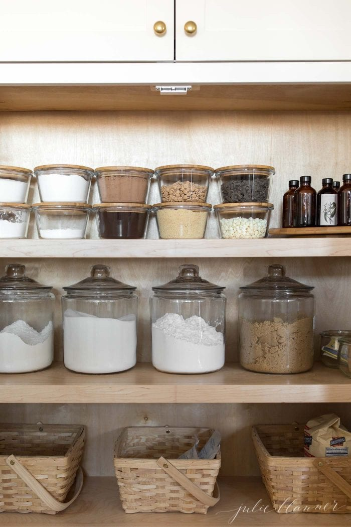 baking cabinet with flour sugar confectioners sugar and brown sugar in jars