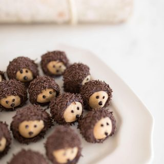 Chocolate Peanut Butter Balls decorated like hedgehogs