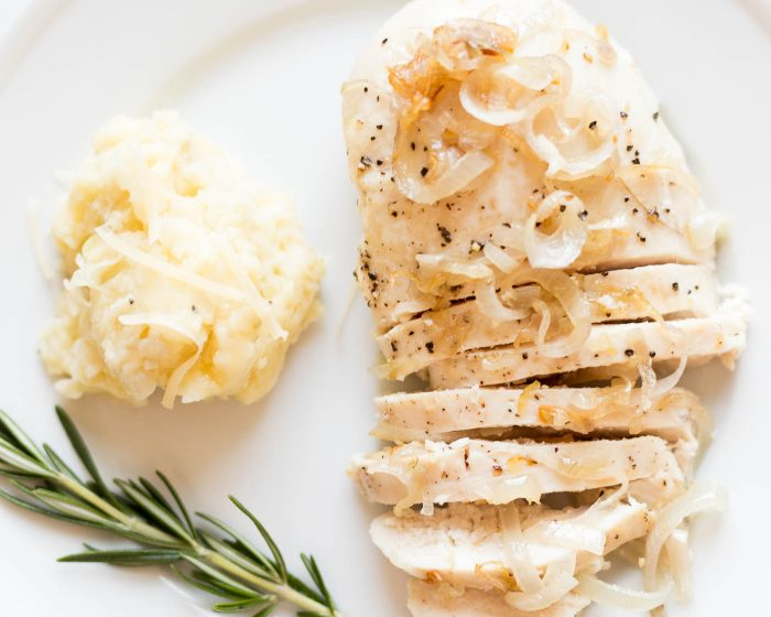 chicken with garlic sauce on a plate