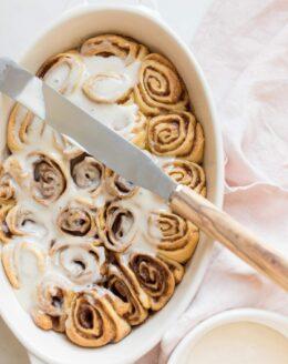 cinnamon roll icing on rolls