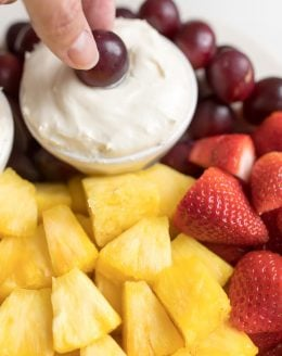 cream cheese fruit dip on a platter of fruit