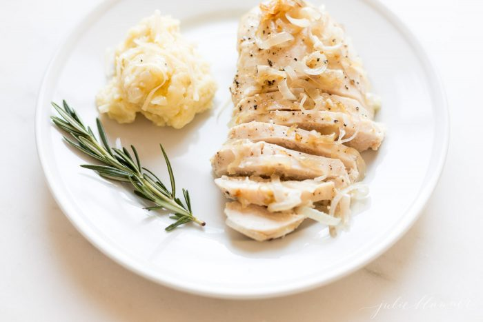 garlic chicken with caramelized shallots on a plate with mashed potatoes