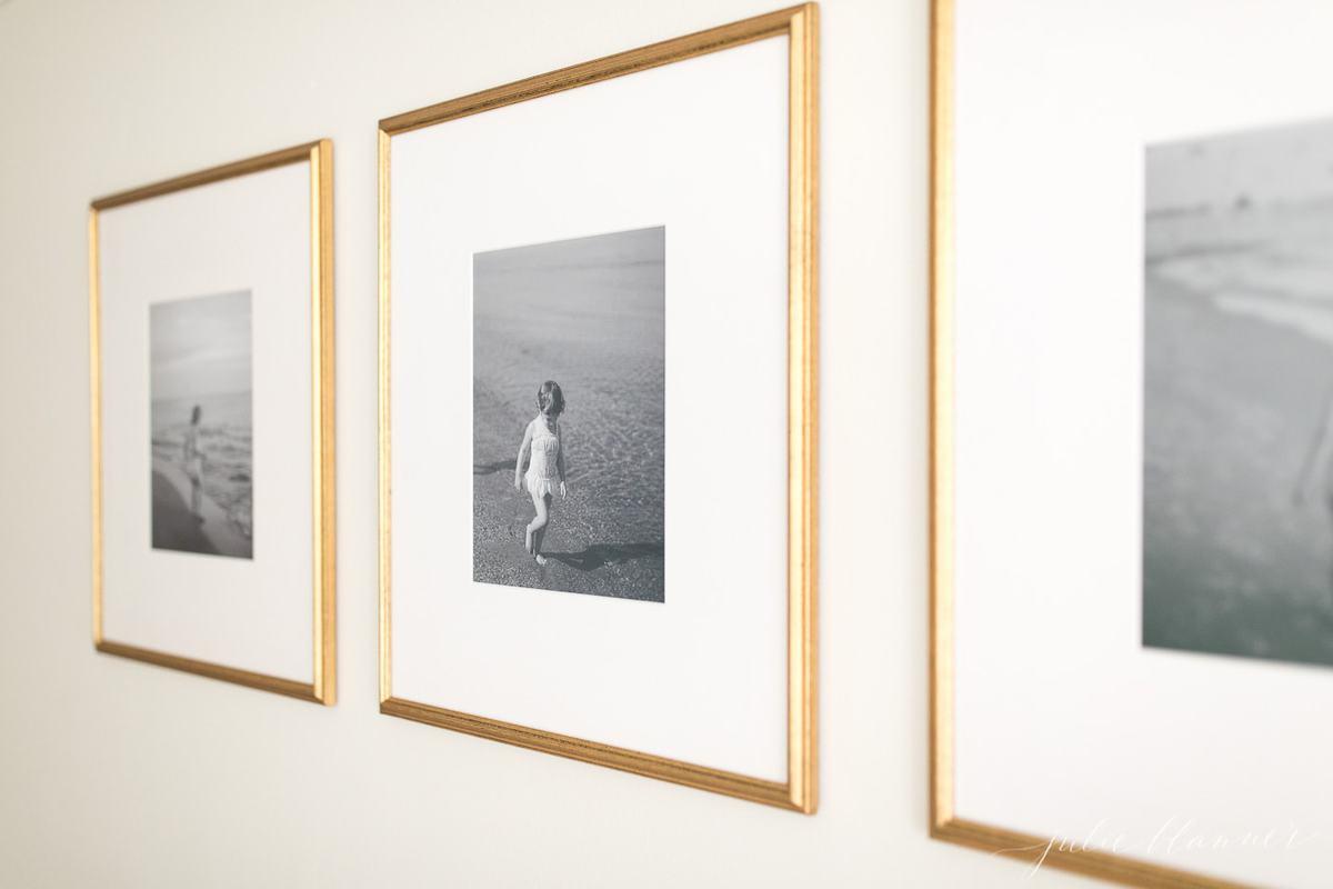 brass photo frames of children on the beach