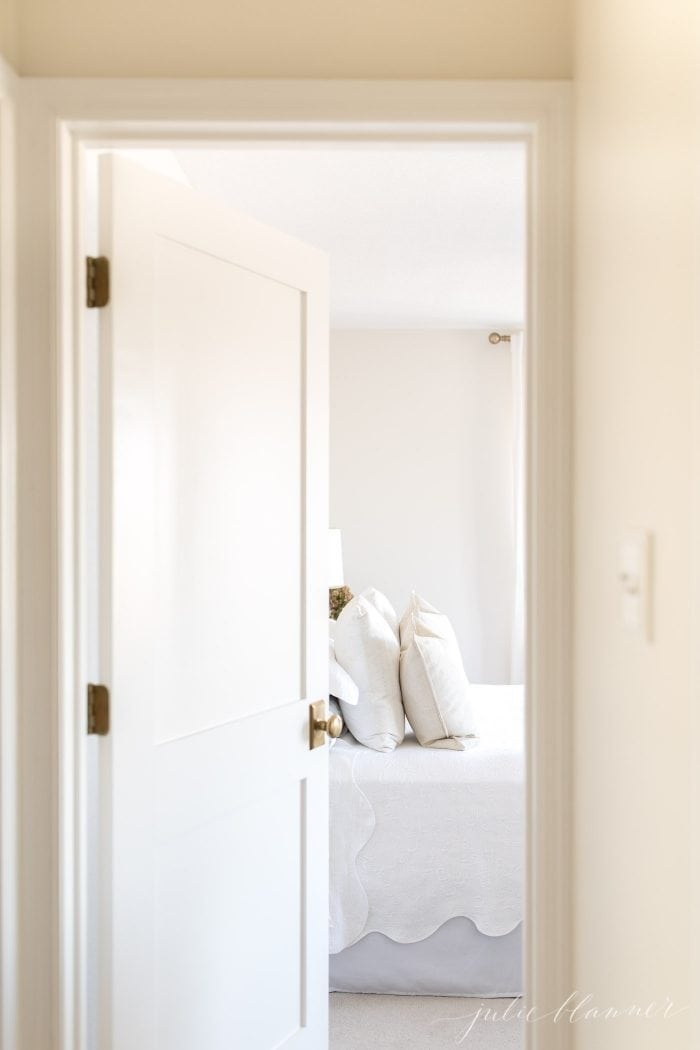 give the illusion of space in a small hallway with new doors that reflect light