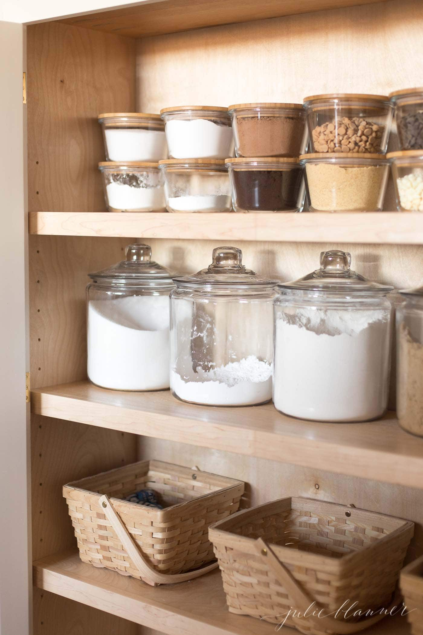 Looking inside a pantry with beautifully organized baking necessities.