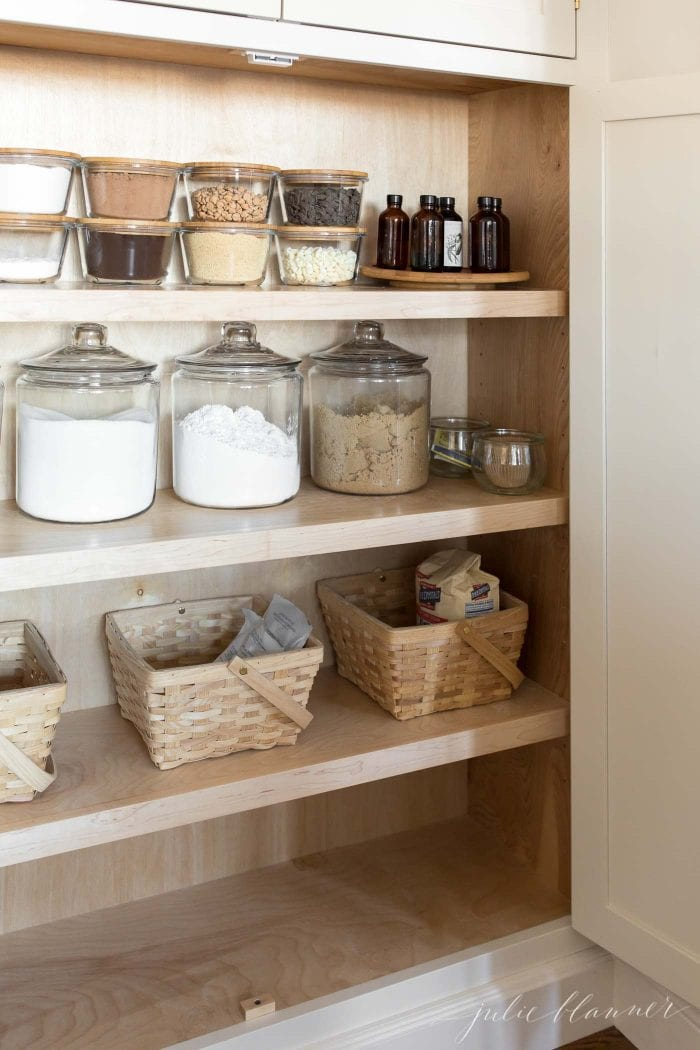 kitchen organization baking ingredients in pantry in glass jars and baskets