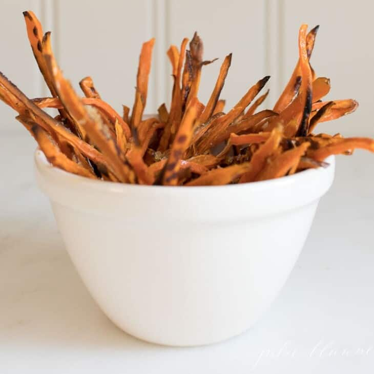 sweet potato fries in cream bowl