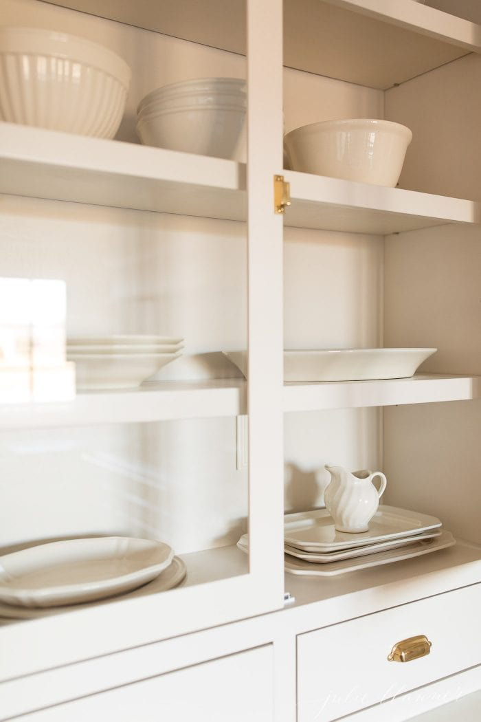 cabinet with platters and mixing bowls