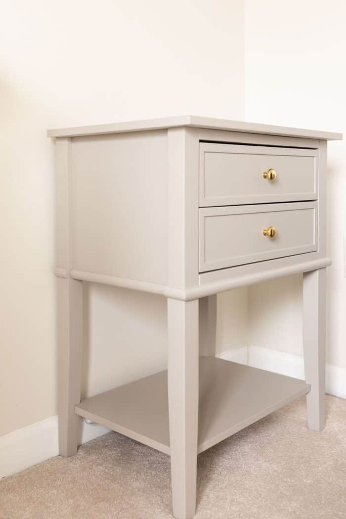 A small gray side table after being painted with a furniture paint tutorial.
