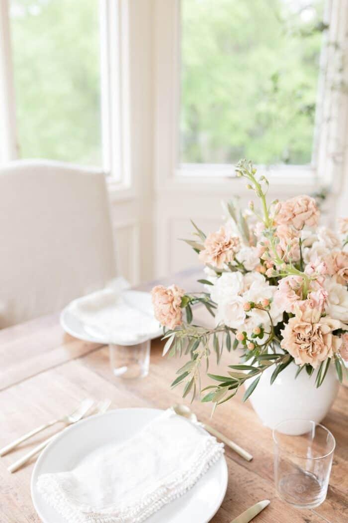peach flowers on a wood farm table.