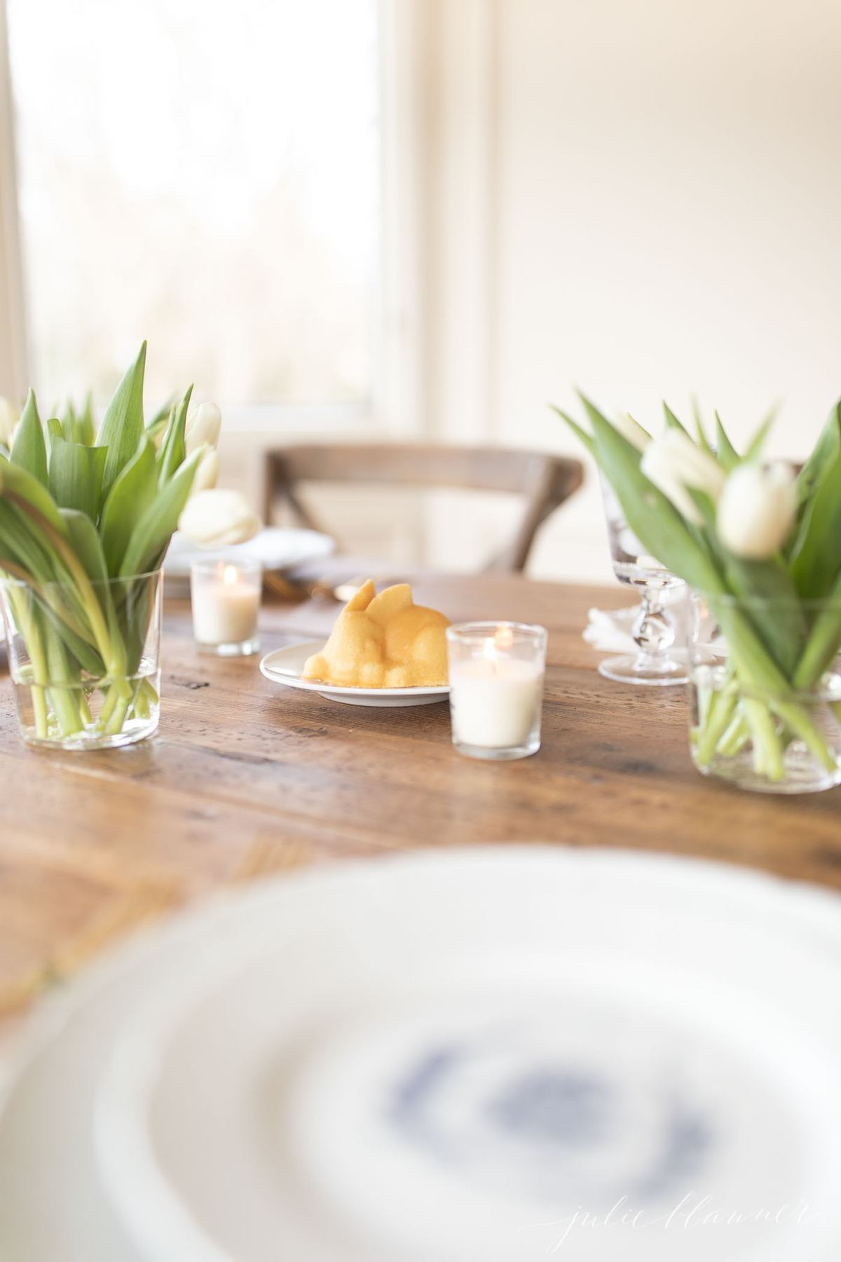 easter table setting and bunny cake centerpiece