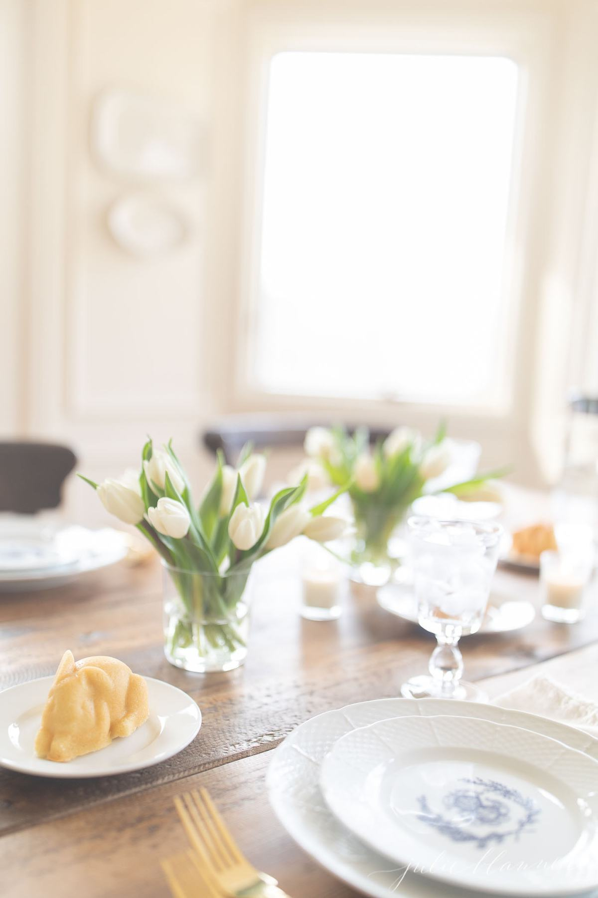 easter cake at each place setting with tulips