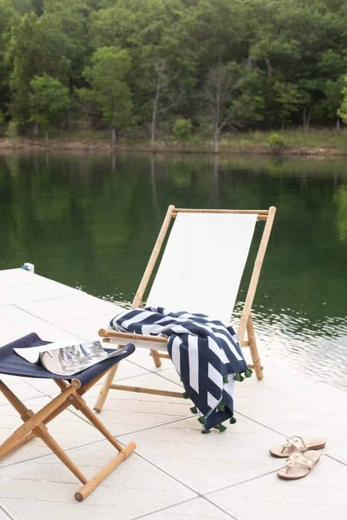 sling chair on dock by lake