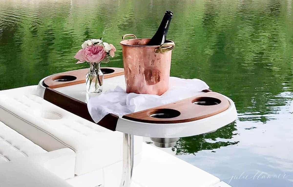 champagne bucket on table on back of boat