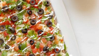 7 layer dip with refried beans, guacamole, pico de gallo, cilantro, green onions, olives and cheese.