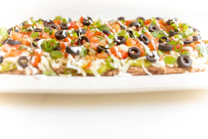Side view of classic 7 layer Mexican dip