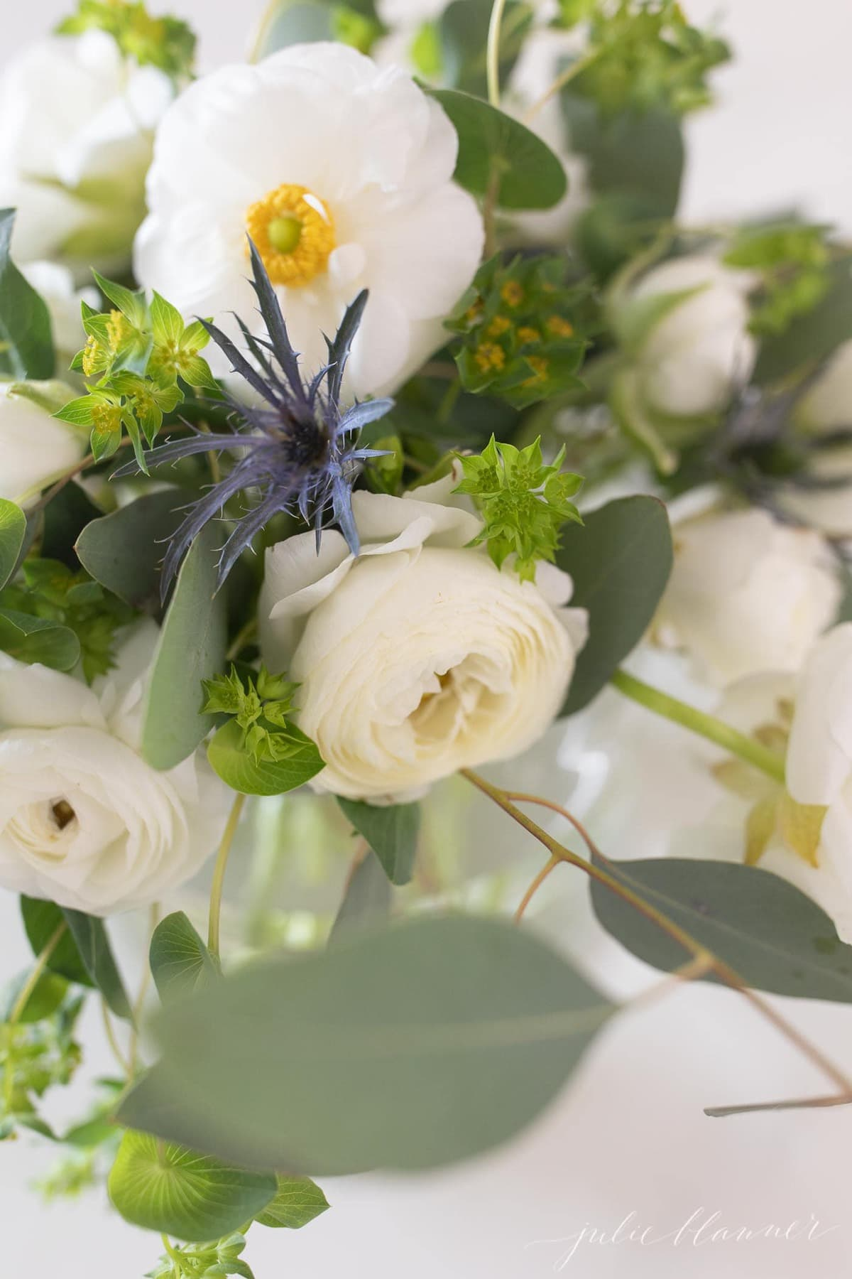 White Ranunculus flower centerpiece close up image