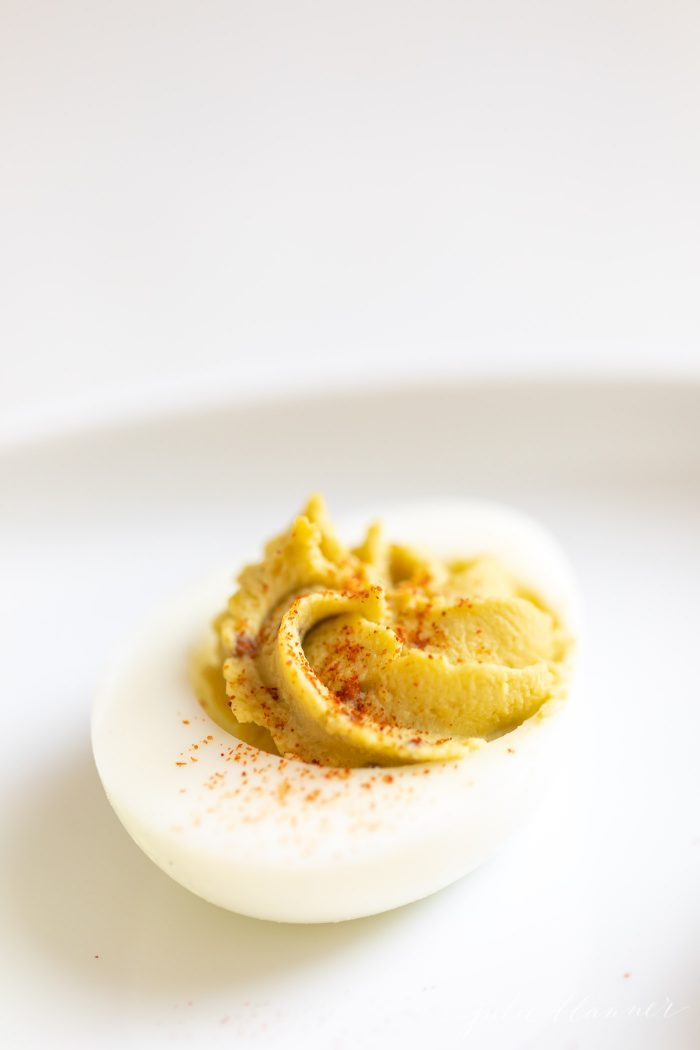 avocado deviled egg with paprika